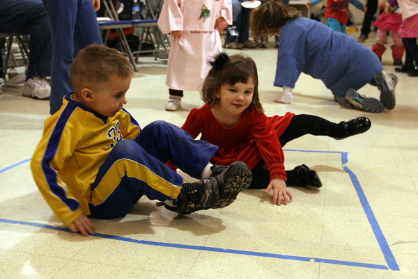 Gloucester: Zach Lavy, 4, and Allie Matus, 2, show off their breakdancing moves during a free concert by Leeny & the Eeny Meenys at Pathways for Children on Thursday. Photo by Kate Glass/Gloucester Daily Times