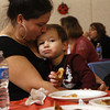 Gloucester: Jaylen Severino, 3, cuddles with his mom, Jaimee Silva, while at a free pizza party and performance by Leeny & the Eeny Meenys at Pathways for Children on Thursday night. Photo by Kate Glass/Gloucester Daily Times