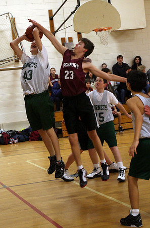 Essex: Rockport's Conor Kuykendall blocks Manchester Essex's Craig Carter during their game at Essex Elementary School yesterday. Rockport won the game 64-63. Photo by Kate Glass/Gloucester Daily Times