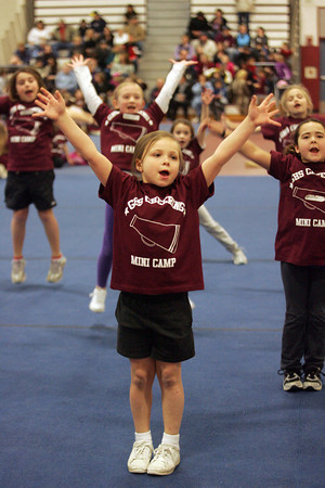 Gloucester: Jenna Hoofnagle, 7, runs through a cheer during Cheerleading Mini Camp at Gloucester High School Thursday afternoon. Mary Muckenhoupt/Gloucester Daily Times