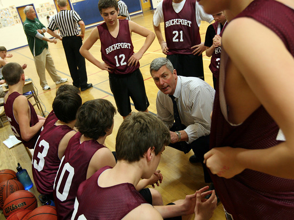 Essex: Rockport Coach Steve Rowell gathers the 8th grade boys basketball team before their game against Manchester Essex at Essex Elementary School yesterday. Photo by Kate Glass/Gloucester Daily Times