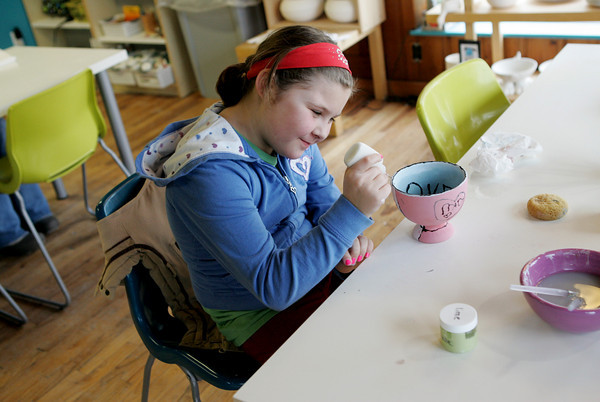 Gloucester: Brianna Bruni, 9, paints a Valentine's Day bowl that she plans to give as a gift while spending a Saturday afternoon at Glazed Paint Your Own Pottery Studio.  Mary Muckenhoupt/Gloucester Daily Times