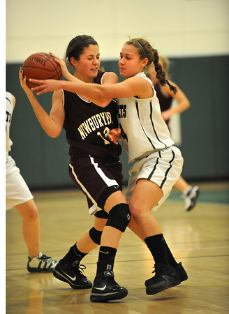 Manchester: Manchester's Jellisa O'Hara puts pressure on Newbury's Molly Rowe last night at MERHS. Desi Smith/Gloucester Daily Times. February 13,2011.