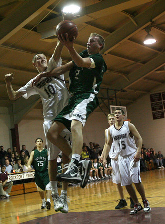 Rockport: Rockport's Dan Gray tries to block Manchester Essex's Joe Mussachia last night. Photo by Kate Glass/Gloucester Daily Times
