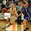 Gloucester: Gloucester's Hannah Cain moves the ball up court past Danvers's Kasey Sherry last night at the Benjamin A Smith Feildhouse. Desi Smith/Gloucester Daily Times. February 18,2010.