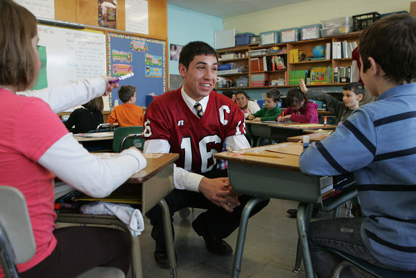 Gloucester: Gloucester High School senior Gilbert Brown chats with Andrew Gabriele, right, and Megan Ciluffo in Julie McGovern's second grade class at Beeman Elementary School as Brown talks to the students about developing good habits Thursday afternoon. The program, which is a collaborative effort between Gloucester High school and the Cape Ann Moose Lodge, consists of eight students who speak to elementary school students about such topics as becoming environmentally friendly and obeying the golden rule. The presenters are attempting to qualify for scholarships offered by the International Moose Organization. Mary Muckenhoupt/Gloucester Daily Times