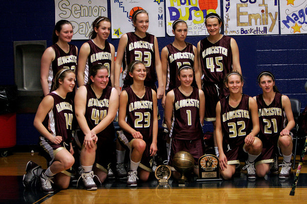 Lynn: The Gloucester girls basketball team celebrates their win over Tewksbury in the Division 2 Championship Game of the Spartan Classic at St. Mary's High School in Lynn yesterday. Photo by Kate Glass/Gloucester Daily Times