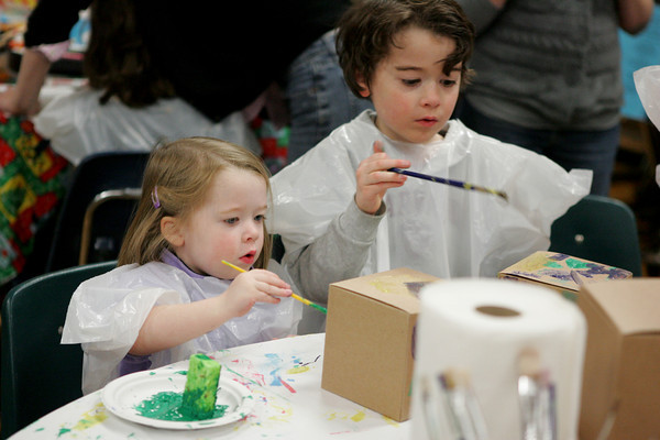 Essex: Cameron Friedrich, 2, and her brother Brady, 6, paint boxes at the art table provided by Cogswell's Grant during Messy Art Night at Essex Elementary School Friday night. Mary Muckenhoupt/Gloucester Daily Times