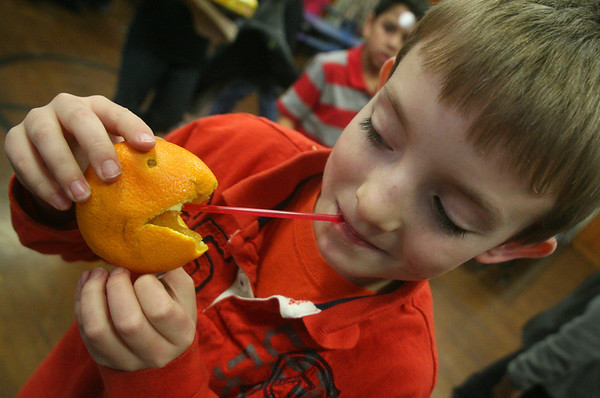 ALLEGRA BOVERMAN/Staff photo.Gloucester Daily Times. Gloucester: Veterans Memorial Elementary School second grader Colby Kokos noticed that the orange he decided to stick a straw into and drink from also looked like Pac-Man during lunchtime on Thursday at the school.