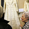 "ALLEGRA BOVERMAN/Staff photo. Gloucester Daily Times. Gloucester: The Women's Guild of Holy Family Parish held a ""Romance""- themed evening on Tuesday night at St. Ann Church. Members brought three generations of wedding dresses to display, wedding photos and wedding album, cake toppers, bridesmaid and mother-of-the-bride dresses and other memorabilia. There was a candy table, cupcakes on every table, and champagne, too. Celia Salafia Gray, right, who was married in 1969, shows her dress, designed by Michael Aiello of Gloucester, and a longtime Priscilla of Boston designer, to Jeannie Flaherty."