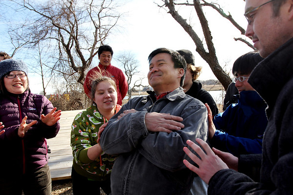 ALLEGRA BOVERMAN/Staff photo. Gloucester Daily Times. Gloucester: Leaning back to others can catch him from falling in a spotting practice, is Yew Cheong, of Project Adventure Japan. Around him are Project Adventure and Project Adventure Japan participants who were meeting and doing activities together at Gloucester High School on Wednesday. From left are: Suzume Sugimura, Miranda Schneider, behind her is Takashi Monden, Dylan Spellman, Tetsu Takano and Tom Waldron.