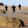 ALLEGRA BOVERMAN/Staff photo. Newburyport Daily News. Newburyport: A family runs together along the beach and around the rocks at Sandy Point State Reservation.