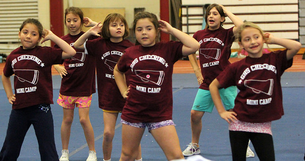 "ALLEGRA BOVERMAN/Staff photo. Gloucester Daily Times. Gloucester: Almost 60 girls participated in the Gloucester Cheer Mini Camp this past week and they held a show for parents and friends on Thursday at the Gloucester High School field house. These are members of the ""B"" team."