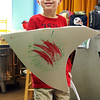 GLOUCESTER—Callahan White, 5, of Gloucester, reveals his sword and shield at the Art Haven on Wednesday morning. Dozens of Cape Ann kids showed up on Wednesday to make their own swards and shields and then watch Lord of the Rings. Jesse Poole/Gloucester Daily Times Feb. 22, 2012