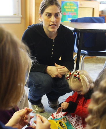 Chelsie Larry of Gloucester talks to a small group of students at Eastern Point Day School about Emanuel syndrome, a rare chromosome abnormality that her daughter McKenna Ciolino, 2, is diagnosed with. Jesse Poole/Gloucester Daily Times Feb. 14, 2012