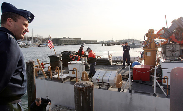 ALLEGRA BOVERMAN/Staff photo. Gloucester Daily Times. Gloucester:The Coast Guard Cutter Grand Isle returned to Gloucester on Friday afternoon after seven months of repairs and 10 days at sea. Sector Commander for Boston, Capt. John Healey, left, watches as the ship is moored.