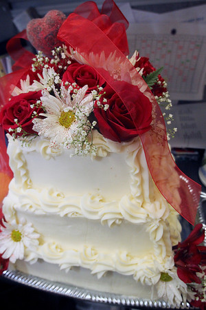 ALLEGRA BOVERMAN/Staff photo. Gloucester Daily Times. Gloucester: The cake that was to be served during the reception at the Day by Day Mock Wedding held on Tuesday morning at the center in Gloucester.