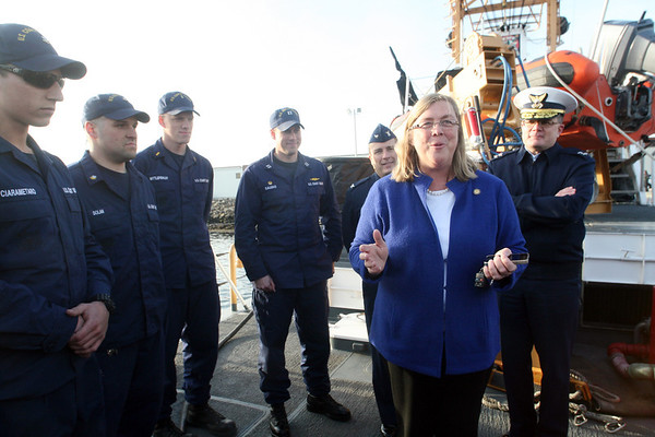ALLEGRA BOVERMAN/Staff photo. Gloucester Daily Times. Gloucester:The Coast Guard Cutter Grand Isle returned to Gloucester on Friday afternoon after seven months of repairs and 10 days at sea. Thomas Ciarametaro of Gloucester, far left, listens as Gloucester Mayor Carolyn Kirk welcomes the crew and ship back.