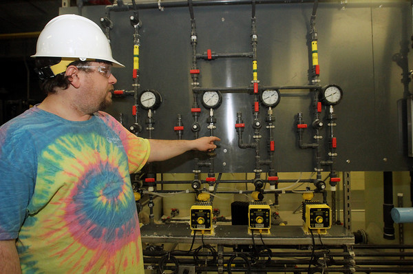 ALLEGRA BOVERMAN/Staff photo.Gloucester Daily Times. Gloucester: Nick Farone, operator of the Bond Hill Water Facility of the water division of the Department of Public Works, talks about the chemicals used to adjust the pH balance of the water there.