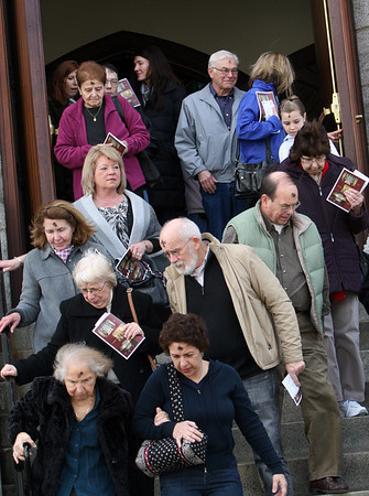 ALLEGRA BOVERMAN/Staff photo. Gloucester Daily Times. Gloucester: Parishioners leave St. Ann Church in Gloucester after Mass on Ash Wednesday afternoon.