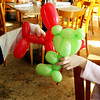 ALLEGRA BOVERMAN/Staff photo. Gloucester Daily Times. Gloucester: Jackson Godfrey, 3, of Peabody, left, and his cousin, Kyla Forsyth, 5, of Gloucester, spar with their balloon animals while waiting with their mothers and grandmother for lunch at Latitude 43 on Tuesday during the Mardi Gras fundraiser for the Cape Ann YMCA.