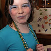 ALLEGRA BOVERMAN/Staff photo. Gloucester Daily Times. Gloucester: Julia Amero 8, of Gloucester, shows off her delicately painted face. She was participating on Tuesday during Mardi Gras festivities and the Cape Ann YMCA's full day fundraiser at Latitude 43. The fundraiser is for Y teens and chaperones to travel to and volunteer in New Orleans during April school vacation and help rebuilt homes destroyed by Hurricanes Katrina and Rita.