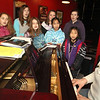 ALLEGRA BOVERMAN/Staff photo. Gloucester Daily Times. Gloucester: Gloucester Stage Youth Acting Workshops continued their weekly session on Friday afternoon with an added component of singing for the next three weeks and an introduction to Broadway songs taught by music teacher Helen Greene, far right. The workshops have also added making art to the workshop during the same session. Singing helps the participants gain confidence using their singing voices to perform with alone and in small groups, and the art component teaches them how to observe, express and feel. From left in front are: Brianna Ward, 9, Sara Wheeler, 10, Annabelle Keefe, 8, Autumn Silva, 9, Amy Petralia, 10 and Zoe Glassman, 9. In back, from left are: Belle Mueller, 12, Lily Gray, 12, and Emma Donald, 14.