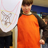 GLOUCESTER—Sean Buckner, 8, of Gloucester, holds up his newly fashioned shield, which would later serve to protect him from a handful of swords swinging at the Art Haven on Wednesday morning, which was also their Lord of the Rings day. Dozens of Cape Ann kids showed up on Wednesday to make their own swards and shields and then watch Lord of the Rings. Jesse Poole/Gloucester Daily Times Feb. 22, 2012