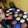ALLEGRA BOVERMAN/Staff photo. Gloucester Daily Times. Gloucester: Samantha Pascucci, 10, and her grandmother Georgeann Morris, both of Gloucester, place their completed bowls on a table to dry during the decorating night held at The Open Door Tuesday evening in preparation for the upcoming Empty Bowl Dinner on Thurs., May 10 from 4-8 p.m. at Cruiseport Gloucester. A second session for decorating will be held on Sat. Mar. 10 from 10 a.m. - noon at 28 Emerson Ave. in Gloucester. For more information, see foodpantry.org or call 978-283-6776, extension 205.