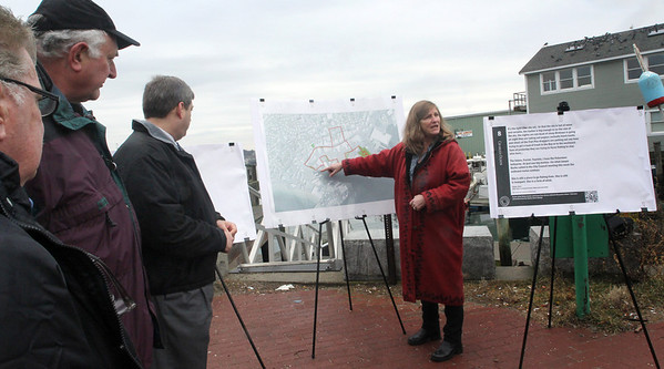 ALLEGRA BOVERMAN/Staff photo. Gloucester Daily Times. Gloucester: Harborwalk is being built. The groundbreaking was held Friday at St. Peter's Square. Community Development Director Sarah Garcia, center, talks in detail about each leg of the Harborwalk plan. From left, are Bob Whynott, Joe Ciolino and Sen. Bruce Tarr.