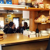 "Christine Desalvo, owner of Christine's Coffee Cup at 25 Union Street in Manchester, watches from the kitchen as her restaurant fill up. Around 11:45 a.m. the restaurant was packed full of high school students, all coming from a half-day of school, all asking for the ""special."" According to Desalvo, this is common routine on half-days. Jesse Poole/Gloucester Daily Times Feb. 08, 2012"