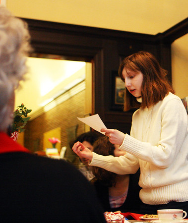 Hannah Sinclair reads one of her poems at the Manchester Public Library during a poetry and tea event on Valentines Day, which was also Hannah's 17th birthday. Jesse Poole/Gloucester Daily Times Feb. 14, 2012