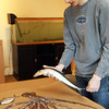 GLOUCESTER—Marine science educator Curtis Sarkin of Rockport prepares for a fun fish-printing walk-in event on Wednesday morning as part of Maritime Gloucester's February vacation program. Jesse Poole/Gloucester Daily Times Feb. 22, 2012