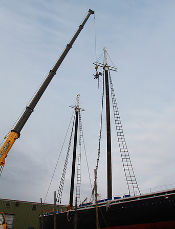 A crew from Mayer Tree Service works to lift the mast of the schooner Adventure for inspection and repair at the Gloucester Maritime Railways on Wednesday morning. Jesse Poole/Gloucester Daily Times Feb. 29, 2012