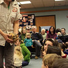 Mona Headen of Critters 'N Creatures holds Taco, the three-banded armadillo, and shows the audience how Taco can roll up into a ball to protect herself. This live animal event was sponsored by Critters 'N Creatures and took place at the Sawyer Free Library on Saturday morning. Jesse Poole/Gloucester Daily Times Jan. 28, 2012