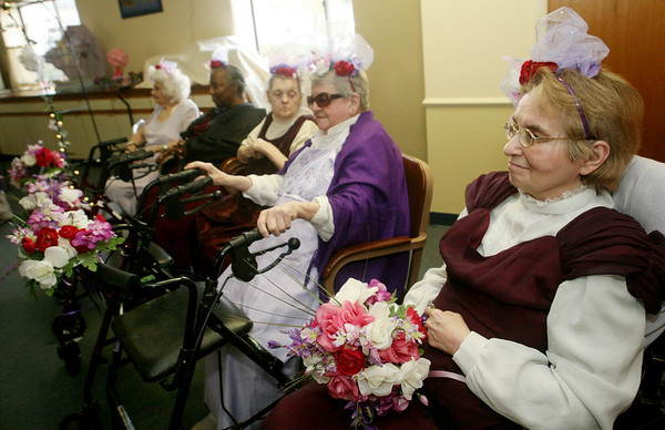 "ALLEGRA BOVERMAN/Staff photo. Gloucester Daily Times. Gloucester: From right are ""bridesmaids"" Elaine Rambler, Eleanor Campbell, Pat Shea, Marsha West and Angie Verga awaiting the start of the ""Mock Wedding"" held at Day by Day on Tuesday."