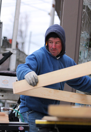 ALLEGRA BOVERMAN/Staff photo. Gloucester Daily Times. Rockport: Carpenter Tim Pierce of Gloucester builds indoor window frames he and the company he works for, Elinskas Enterprises of Rockport, are doing for a building they are renovating downtown.