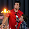 ALLEGRA BOVERMAN/Staff photo. Gloucester Daily Times. Gloucester: During a PTO-sponsored enrichment program at Beeman Elementary School on Friday given by the Museum of Science. Museum educator George Pechmann supervises third grader Logan Weickowski as he burns a piece of flash paper in a Jacob's Ladder device. This device explains how air acts as an insulator, demonstrates how heat rises as the current creates the heat, and that sparks then turn into other kinds of energy.
