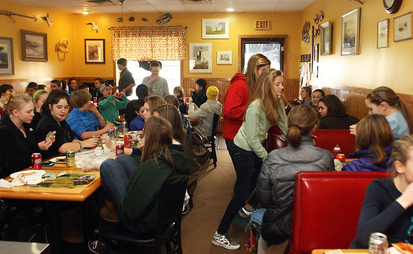 "Christine's Coffee Cup at 25 Union Street in Manchester fills up around 11:45 a.m., packed full of high school students, all coming from a half-day of school, all asking for the ""special,"" which is two slices of pizza and a soda. According to owner Christine Desalvo, this is common routine on for the students on half-days. Jesse Poole/Gloucester Daily Times Feb. 08, 2012"