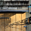 ALLEGRA BOVERMAN/Staff photo. Gloucester Daily Times. Rockport: Late afternoon shadows on a barn door in Rockport.