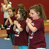 ALLEGRA BOVERMAN/Staff photo. Gloucester Daily Times. Gloucester: Almost 60 girls participated in the Gloucester Cheer Mini Camp this past week and they held a show for parents and friends on Thursday at the Gloucester High School field house. Alexis Johnson, far right, was doing a routine with other members of her C2 team.