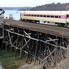 ALLEGRA BOVERMAN/Staff photo. Gloucester Daily Times. Gloucester: The outbound commuter MBTA train travels very slowly over the Annisquam River Bridge on Wednesday afternoon just after leaving the Gloucester station.