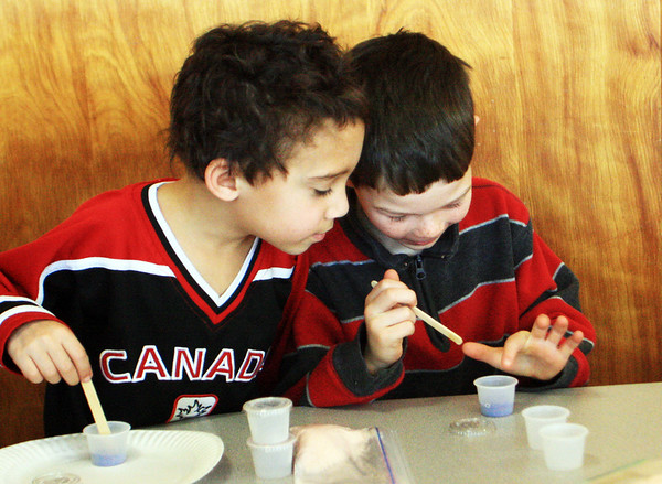 "First-graders Xavier Beauguard, left, and Jesse Oliver poke at ""magic sand"" during an interactive science program sponsored by Top Secret Science on Monday morning at Manchester Memorial Elementary School. Jesse Poole/Gloucester Daily Times Jan. 30, 2011"