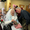 "ALLEGRA BOVERMAN/Staff photo. Gloucester Daily Times. Gloucester: <br /> During the ""Mock Wedding"" held at Day by Day on Tuesday. Al and his wife Rosi Hall, at right, of Danvers, greet Al's mother, Alyce Brayman, the ""Bride"" and Bill Grandmont, left, the ""Groom,"" after the ceremony. Al asked his mom, ""Do I have to call him Dad?"""