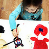 GLOUCESTER—After finishing a red and blue heart, Talia Conlon, 5, moves on to paint a cat at Art Haven in Gloucester during the Paint Big event, at which children helped paint giant canvases on Monday morning. Jesse Poole/Gloucester Daily Times Feb. 20, 2012