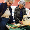 Carolyn Munroe Budrow, left, and Marjorie Melamson, both of Gloucester, look through a scrapbook that was assembled by their troop leader Mabel Pettipas when they would have been young teenagers. This was at the Rose Baker Senior Center on Tuesday morning, where Girl Scouts of all ages met to reminisce, look at old Girl Scouts scrapbooks, photos and uniforms, and to participate in the filming of a documentary about the history of the Girl Scouts on Cape Ann in celebration of the up-coming Girl Scouts 100th Anniversary. Jesse Poole/Gloucester Daily Times Feb. 21, 2012