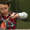 ALLEGRA BOVERMAN/Staff photo. Gloucester Daily Times. Gloucester: Jameson Shamberger, 8, of Gloucester, carefully paints an erupting volcano design on his bowl during the decorating night held at The Open Door Tuesday evening in preparation for the upcoming Empty Bowl Dinner on Thurs., May 10 from 4-8 p.m. at Cruiseport Gloucester. A second session for decorating will be held on Sat. Mar. 10 from 10 a.m. - noon at 28 Emerson Ave. in Gloucester. For more information, see foodpantry.org or call 978-283-6776, extension 205.
