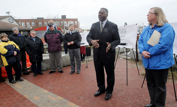 ALLEGRA BOVERMAN/Staff photo. Gloucester Daily Times. Gloucester: Harborwalk is being built. The groundbreaking was held Friday at St. Peter's Square. Louis Elisa, center, the executive secretary and director of port development, was on hand. Mayor Carolyn Kirk is at right.