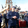 ALLEGRA BOVERMAN/Staff photo. Gloucester Daily Times. Gloucester:The Coast Guard Cutter Grand Isle returned to Gloucester on Friday afternoon after seven months of repairs and 10 days at sea. Capt. Christjan Gaudio, of Rockport, center front, talks with the crew on board. Behind him from left are Gloucester Mayor Carolyn Kirk, Capt. John Healey, sector command for Boston, and Rear Admiral Daniel A. Neptun.