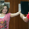 ALLEGRA BOVERMAN/Staff photo. Gloucester Daily Times. Gloucester: <br /> Beeman Elementary School third grader Cassidy Briere's hair is fluffed up by the static electricity of a van de Graaf Generator, as she stands on a little stool and touches the generator, during a PTO-sponsored enrichment program at Beeman Elementary School on Friday given by the Museum of Science. Museum educator George Pechmann holds a mirror up so she can see her hair reacting.